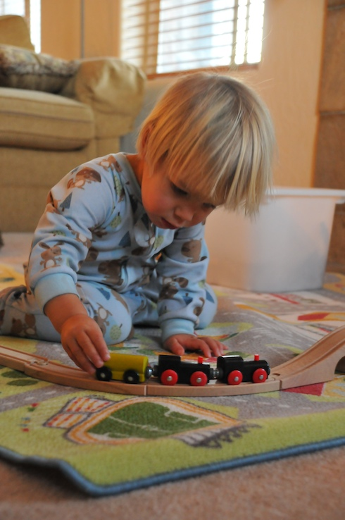 Boys play with trains
