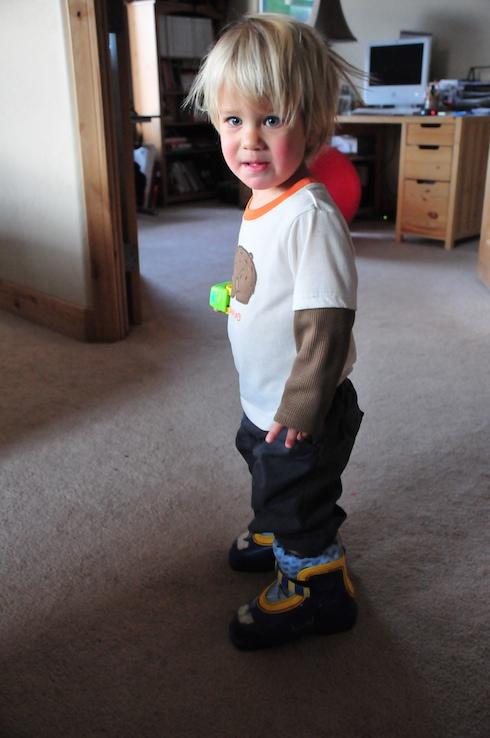 Kid in ski boots